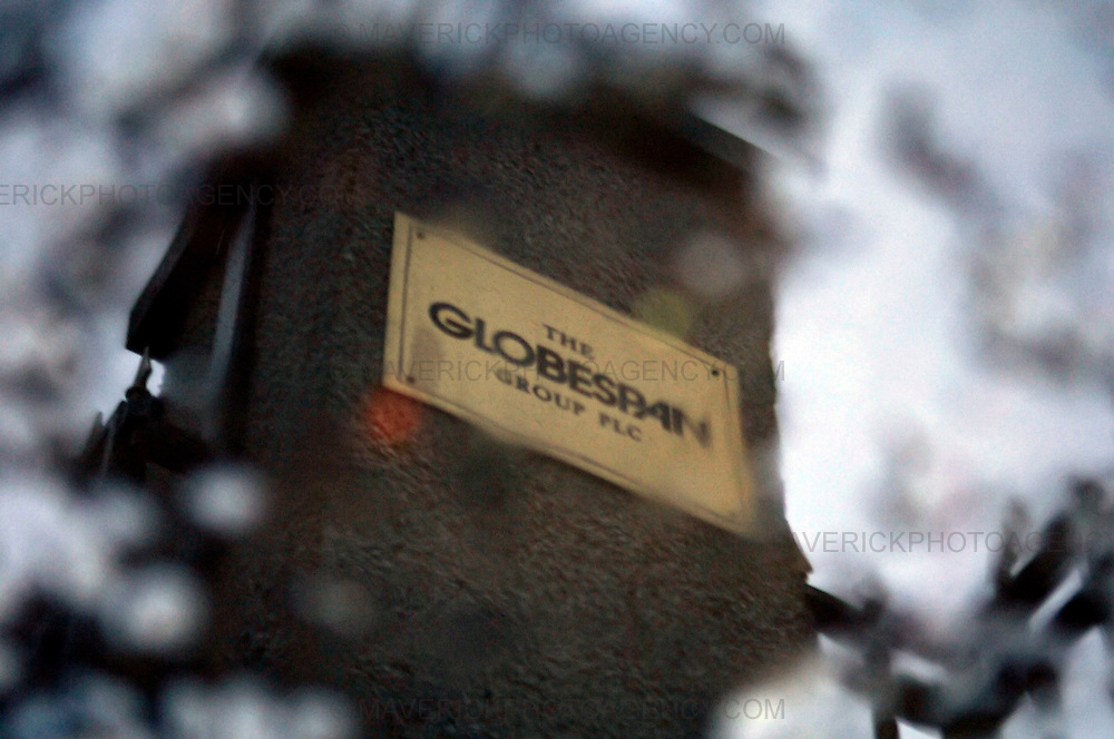 Flyglobespan, Scotland's largest airline, has gone bust, leaving about 5,000 travellers stranded abroad and 800 staff out of a job...More than 100,000 people have booked Christmas breaks with the company, which went into administration last night. Tens of thousands will receive no compensation for the loss. ..Picture shows a plaque reflected in a puddle outside the Globespan Groups headquarters in Edinburgh.