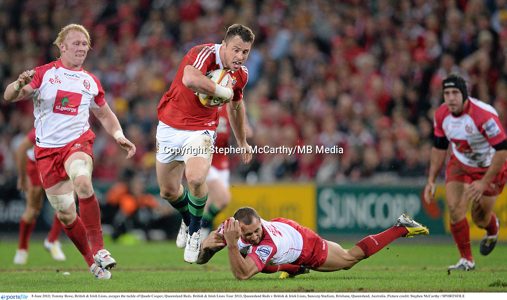 8 June 2013; Tommy Bowe, British & Irish Lions, escapes the tackle of Quade Cooper, Queensland Reds. British & Irish Lions Tour 2013, Queensland Reds v British & Irish Lions, Suncorp Stadium, Brisbane, Queensland, Australia. Picture credit: Stephen McCarthy / SPORTSFILE