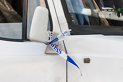 © Licensed to London News Pictures. 08/08/2019. London, UK.  Police tape seen on a van at the scene scene in Leyton this morning in Leyton High Road, where a police officer has been left in a critical condition after being stabbed repeatedly whilst attempting to stop a van in east London. The injured Police Officer, believed to be aged in his thirties, was rushed to hospital and is in a critical but stable condition..  Photo credit: Vickie Flores/LNP