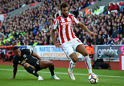 Eric Maxim Choupo Moting of Stoke City takes on Luis Antonio Valencia of Manchester United - Mandatory by-line: Matt McNulty/JMP - 09/09/2017 - FOOTBALL - Bet365 Stadium - Stoke-on-Trent, England - Stoke City v Manchester United - Premier League