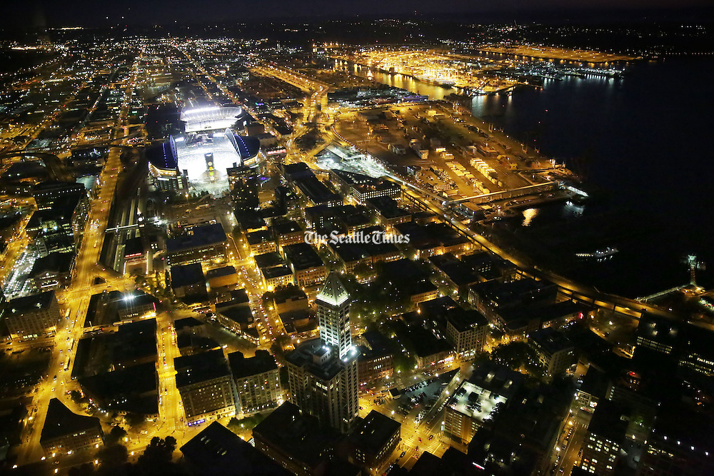 View of CenturyLink Field at night taken from the 73rd floor of the Columbia Center from the Sky View Observatory. <br /> <br /> Erika Schultz / The Seattle Times