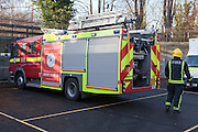 London Fire Brigade, station training session. A Fire fighters with the fire engine.