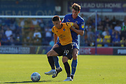 Bristol Rovers attacker Tom Nichols (10) and AFC Wimbledon defender Ryan Delaney (21) battles for possession during the EFL Sky Bet League 1 match between AFC Wimbledon and Bristol Rovers at the Cherry Red Records Stadium, Kingston, England on 21 September 2019.