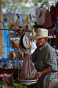 A farmer weighs a purchase at the Friday bazaar in San Sebastian, Puerto Rico. (photo by Charleston SC photographer Richard Ellis)