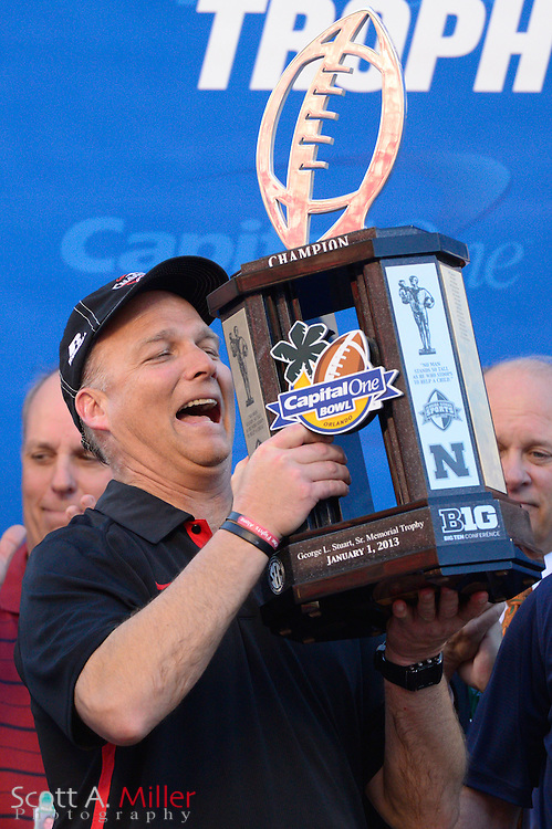 Georgia Bulldogs head coach Mark Richt with the winners trophy following the Bulldogs 45-31 win over the Nebraska Cornhuskers in the Capital One Bowl at the Florida Citrus Bowl on Jan 1, 2013 in Orlando, Florida. ..©2012 Scott A. Miller..