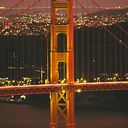 Golden Gate Bridge at night with San Francisco California skyline