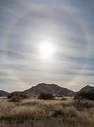 A 22 degree halo over the Dragoon Mountains.