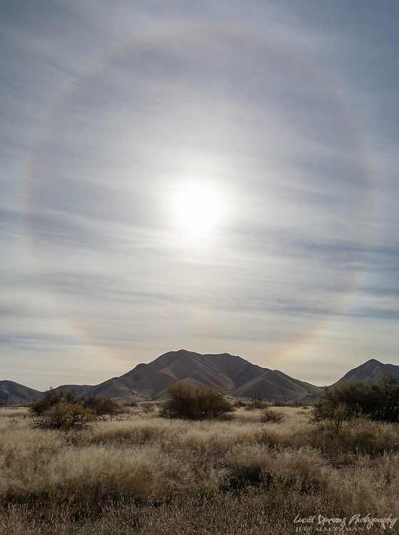 A 22 degree halo over the Dragoon Mountains.