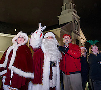 Mrs. Claus and Santa with Mayor Ed Engler as they count down for the lighting of the tree in Veteran's Square following the Holiday Parade through downtown on Saturday evening.  (Karen Bobotas/for the Laconia Daily Sun)
