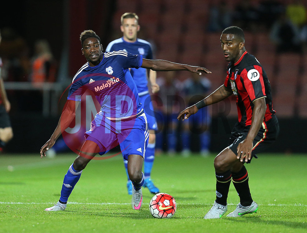 Sammy Ameobi of Cardiff City  and Sylvain Distin of Bournemouth- Mandatory by-line: Paul Terry/JMP - 07966386802 - 31/07/2015 - SPORT - FOOTBALL - Bournemouth,England - Dean Court - AFC Bournemouth v Cardiff City - Pre-Season Friendly