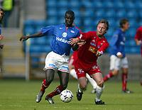 Fotball, 25. juni 2003, NM, If-cup, Vålerenga- Sandefjord 2-1. Sami Mahlio, Sandefjord, og Pa-Modou Kah, Vålerenga