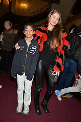 GYUNEL BOATENG and her son OSCAR BOATENG at the opening night of Cirque du Soleil's award-winning production of Quidam at the Royal Albert Hall, London on 7th January 2014.