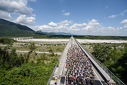 The peloton speed underneath of their approach to the climb on Stage 2 of the Giro Rosa - a 122.2 km road race, between Zoppola and Montereale Valcellina on July 1, 2017, in Pordenone, Italy. (Photo by Sean Robinson/Velofocus.com)