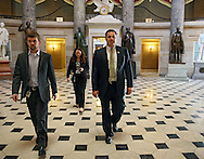 Representative Bruce Braley (D-IA) walks through Statuary Hall in the US Capitol Building on his way to vote on the House floor with his Communications Director Jeff Giertz in Washington, DC on Wednesday, April 10, 2013.