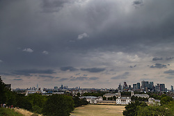Dark clouds mass above the London skyline as predicted thunderstorms approach the capital. Greenwich, London, August 07 2018.