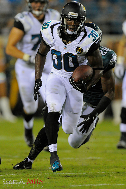 Jacksonville Jaguars running back Jordan Todman (30) scores on a 63-yard run during a preseason NFL game against the Philadelphia Eagles at EverBank Field on Aug. 24, 2013 in Jacksonville, Florida. The Eagles won 31-24.<br /> <br /> &copy;2013 Scott A. Miller