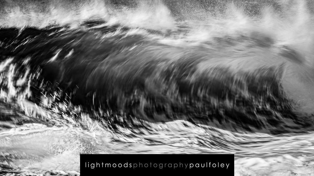 Breaking wave photographed at slow shutter speed
