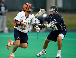 Virginia Cavaliers A George Huguely (11) runs around Georgetown Hoyas D Matt Heiderman (19)..The Virginia Cavaliers men's lacrosse team faced the Georgetown Hoyas in a Fall Ball Scrimmage held at the University Hall Turf Field in Charlottesville, VA on October 12, 2007.