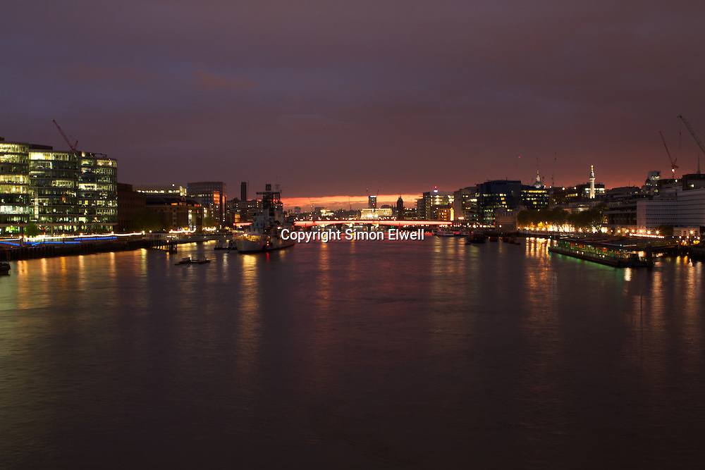 London Bridge and the pool of London at sunset viewed from Tower Bridge