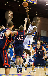 November 30, 2009; San Jose, CA, USA;  San Jose State Spartans guard Chris Jones (24) shoots over Saint Mary's Gaels guard Mickey McConnell (32) during the second half at the Event Center Arena.  Saint Mary's defeated San Jose State 78-71.