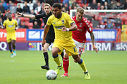 AFC Wimbledon striker Andy Barcham (17) dribbling away from Charlton Athletic attacker Billy Clarke (10) during the EFL Sky Bet League 1 match between Charlton Athletic and AFC Wimbledon at The Valley, London, England on 28 October 2017. Photo by Matthew Redman.