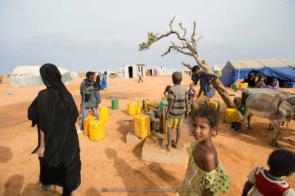 Children collecting water at the Mbera camp for Malian refugees in Mauritania on 2 March 2013.