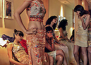 Indian models look on during the trial fittings of creations by Indian designer Rina Dhaka in New Delhi, India, Thursday, April 22, 2004. India's largest fashion event showcasing the creations of 57 designers is scheduled from April 27 to May 3, 2004. (AP Photo/Sebastian John)