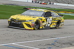 April 6, 2018 - Fort Worth, TX, U.S. - FORT WORTH, TX - APRIL 06: Monster Energy NASCAR Cup Series driver Daniel Suarez (19) drives down pit road during practice for the O'Reilly Auto Parts 500 on April 6, 2018 at Texas Motor Speedway in Fort Worth, Texas.  (Photo by George Walker/Icon Sportswire) (Credit Image: © George Walker/Icon SMI via ZUMA Press)