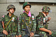 May 19 - BANGKOK, THAILAND: Thai troops take up fighting positions along Rama IV Road opposite Lumpini Park during the Thai government crack down against Red Shirt and anti government protesters. The Royal Thai Army attacked anti-government protesters May 19 with troops and armored personnel carriers. Photo by Jack Kurtz