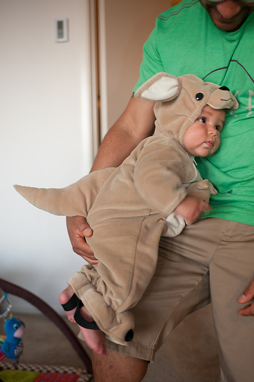 father holding son dressed in kangaroo costume