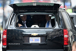 © London News Pictures. 22/04/2016. London, UK. Twoseciret derive agents watch from the rear of a vehicle as British prime minister David Cameron greets President of the United States Barak outside 10 Downing Street in London ahead of a meeting between the two leaders. President Obama is expected to comment on the upcoming referendum on Britain's membership of the EU. Photo credit: Ben Cawthra/LNP
