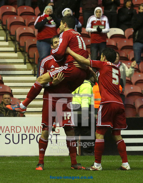 Picture by Paul Gaythorpe/Focus Images Ltd +447771 871632.26/01/2013.Emmanuel Ledesma congratulates Lukas Jutkiewicz of Middlesbrough on scoring the first goal against Aldershot Town during the FA Cup match at the Riverside Stadium, Middlesbrough.