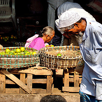 Man Carrying Large Bag at Chor Bazaar Market in Mumbai, India<br />
