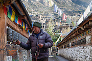 Man turning prayer wheels in Manang (Nepal)