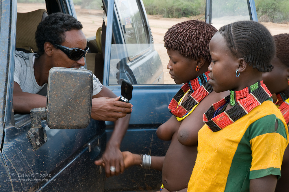 Even though the Omo Valley is less than a days drive from Awassa, many Ethiopians from the north have never seen the people of the south.  A camera on a mobile phone is still a camera and 1 Birr (Ethiopian currency) is demanded.