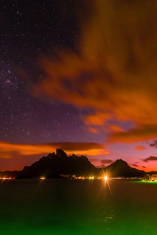 Night scene with a starry sky and Mt. Otemanu, Bora Bora, French Polynesia.