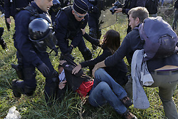 October 27, 2016 - Calais, Nord-Pas-de-Calais-Picardie, France - Police officers and activists struggle. The 4th day of the eviction of the jungle in Calais saw the continue demolition of the huts in the Jungle, as well as the first arrests of people who didn'Äôt leave and some minor clashes with activists opposed to the eviction. (Credit Image: © Michael Debets/Pacific Press via ZUMA Wire)