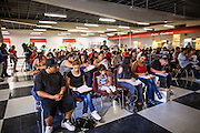 """25 AUGUST 2012 - PHOENIX, AZ:  People start working on their deferred action paperwork at a workshop in Phoenix Saturday. Hundreds of people lined up at Central High School in Phoenix to complete their paperwork to apply for """"Deferred Action"""" status under the Deferred Action for Childhood Arrivals (DACA) program announced by President Obama in June. Volunteers and lawyers specialized in immigration law helped the immigrants complete the required paperwork. Under the program, the children of undocumented immigrants brought to the US before they turned 16 years old would not be subject to deportation if they meet a predetermined set of conditions.    PHOTO BY JACK KURTZ"""