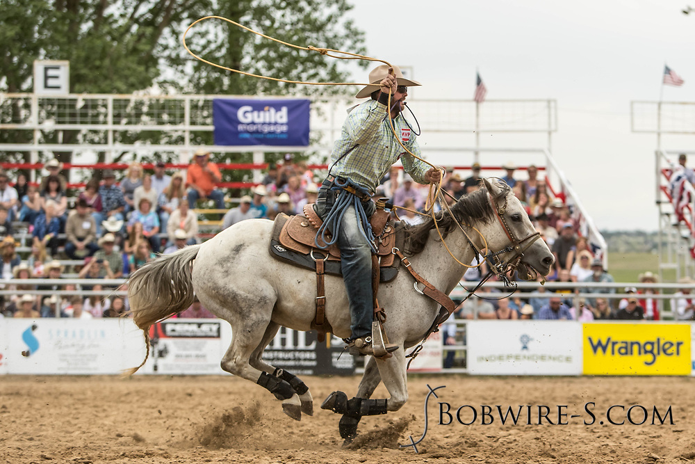 Kyle Dickens makes his tie-down roping run during the third performance of the Elizabeth Stampede on Sunday, June 3, 2018.