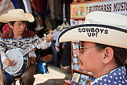 "Mar. 8, 2009 -- BANGKOK, THAILAND:  The ""Blue Mountain Boys,"" a Thai bluegrass duo perform and sell CDs in the Chatuchak Weekend Market. The market covers an area of 35 acres with more than 15,000 shops and stalls. It has over 200,000 visitors each day it's open (Friday - Sunday), and they spend an estimated total of 30 million baht (approx US$750,000). The range of products on sale is extensive, and includes household accessories, handicrafts, religious artifacts, art, antiques, live animals (which unfortunately are frequently caged in cruel conditions), books, music, clothes, food, plants and flowers. Photo by Jack Kurtz / ZUMA Press"