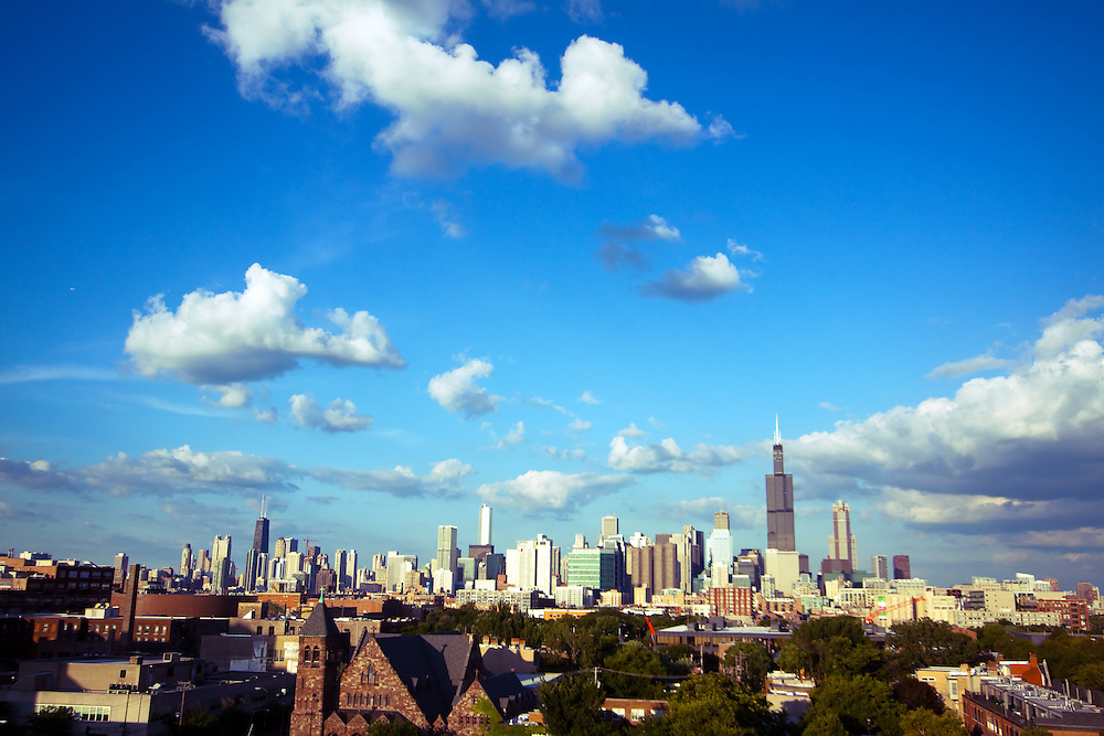 It's a warm summer afternoon in Chicago, IL as puffy white clouds float over the famous skyline of the city.