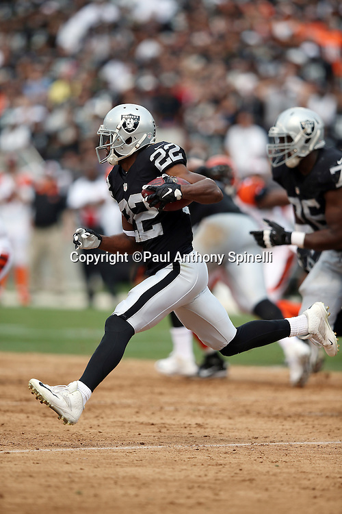 Oakland Raiders running back Taiwan Jones (22) runs with the ball on a second quarter reverse during the 2015 NFL week 1 regular season football game against the Cincinnati Bengals on Sunday, Sept. 13, 2015 in Oakland, Calif. The Bengals won the game 33-13. (©Paul Anthony Spinelli)