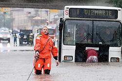 Bus stuck in the water after heavy rain on September 17, 2010, in Ljubljana, Slovenia. (Photo by Matic Klansek Velej / Sportida)