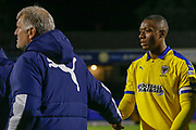 AFC Wimbledon forward Marcus Forss (15) shakes the hand of AFC Wimbledon Manager Glyn Hughes during the EFL Trophy match between Southend United and AFC Wimbledon at Roots Hall, Southend, England on 13 November 2019.