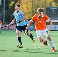 BLOEMENDAAL  - Merijn Bos, (Bl'daal)  met Job Holland (Nijmegen) , competitiewedstrijd junioren  landelijk  Bloemendaal JA1-Nijmegen JA1 (2-2) . COPYRIGHT KOEN SUYK