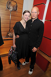 CAMILLA RUTHERFORD and DOMINIC BURNS at a party in aid of the charity Best Buddies held at the Hogan store, 10 Sloane Street, London SW10 on 13th May 2009.