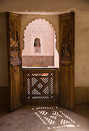 View from a room inside the Ben Youssef Medersa school, looking onto an inner courtyard. http://www.gettyimages.com/detail/photo/ben-youssef-medersa-royalty-free-image/97851721
