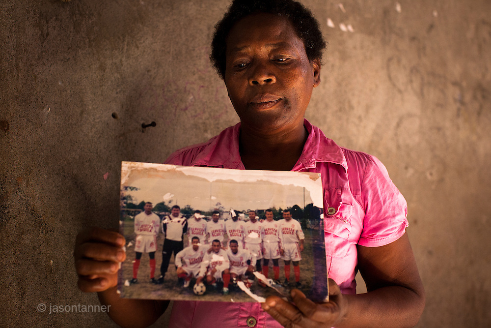 Ecuador: Dona Marianera holds a picture of a football team with her son Jose Luis (bottom right). Jose was one of 8 football team members to be killed that day<br /> <br /> In the coming days she will receive the remains of her son, killed twelve years ago in Colombia. <br /> <br /> Angelina has previously met with Dona Marianera during previous visits to Ecuador in 2002 and 2010. Dona Marianera has 8 children and is suffering from cancer; likely to be related to contamination of the nearby water course by the oil industry (Texaco). <br /> <br /> The UN refugee agency&rsquo;s new Special Envoy of High Commissioner Antonio Guterres, Ms. Angelina Jolie, is visiting Ecuador this weekend in her first field visit since being appointed to her new position this month.<br /> <br /> Ms. Jolie, who conducted more than 40 field visits over the last decade<br /> as UNHCR&rsquo;s Goodwill Ambassador, is on her third trip to Ecuador to<br /> assess the current situation for refugees from Colombia &ndash; the largest<br /> refugee population in Latin America.<br /> <br /> Ecuador currently hosts some 56,000 refugees, 21,000 asylum-seekers and continues to receive 1,300 new applications for protection each month from people fleeing Colombia&rsquo;s ongoing violence.  Many live in the remote and poor northern areas of the country close to the Colombian border.<br /> <br /> &copy;UNHCR/JTanner/April 2012