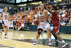 20 March 2010: Jamie McFarlin leans in trying to impede the progress of Erika Bruinsma. The Flying Dutch of Hope College fall to the Bears of Washington University 65-59 in the Championship Game of the Division 3 Women's NCAA Basketball Championship the at the Shirk Center at Illinois Wesleyan in Bloomington Illinois.