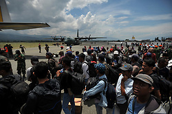 October 6, 2018 - Palu, Central Sulawesi, Indonesia - Residents wait to board a military plane for evacuation at the airport in Palu, Central Sulawesi, Indonesia, 06 October 2018. According to reports, at least 1,648 people have died after a series of powerful earthquakes hit Central Sulawesi on 28 September 2018 and triggered a tsunami. Dasril Roszandi  (Credit Image: © Dasril Roszandi/NurPhoto/ZUMA Press)